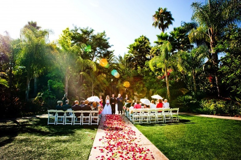 Small destination wedding ceremony aisle with rose petals