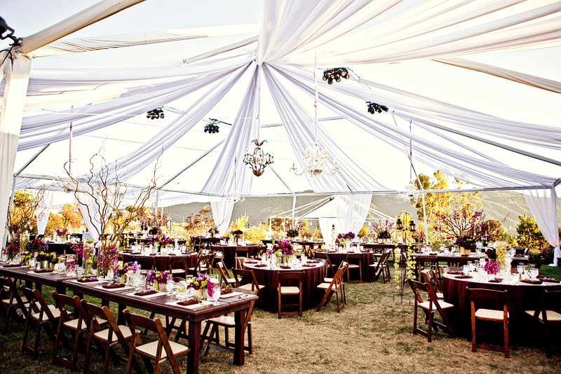 Open-air-tented-wedding-reception-with-round-tables.full