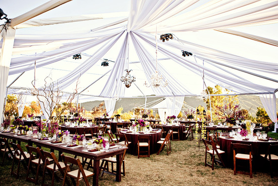 open air tented wedding reception with round tables