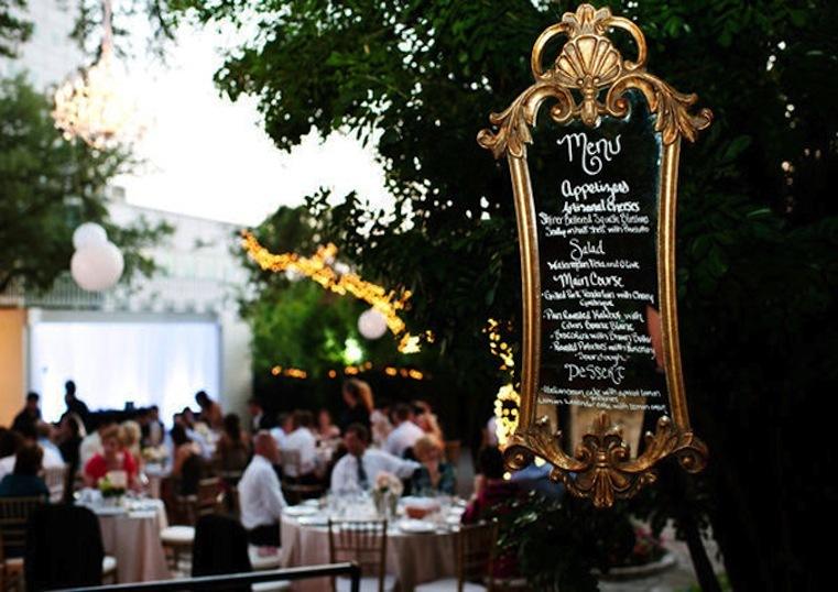 Vintage-wedding-idea-reception-menu-scrawled-on-framed-mirror.full