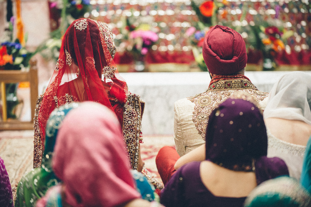 Indian-wedding-ceremony-guests-seated-on-floor.full