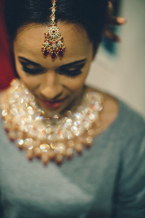 Indian Bride Getting Ready Wears Ornate Jewelry