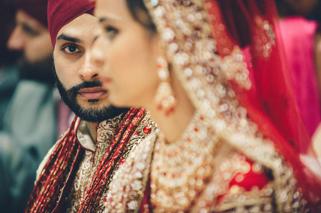 Indian-groom-looks-at-bride-lovingly.full