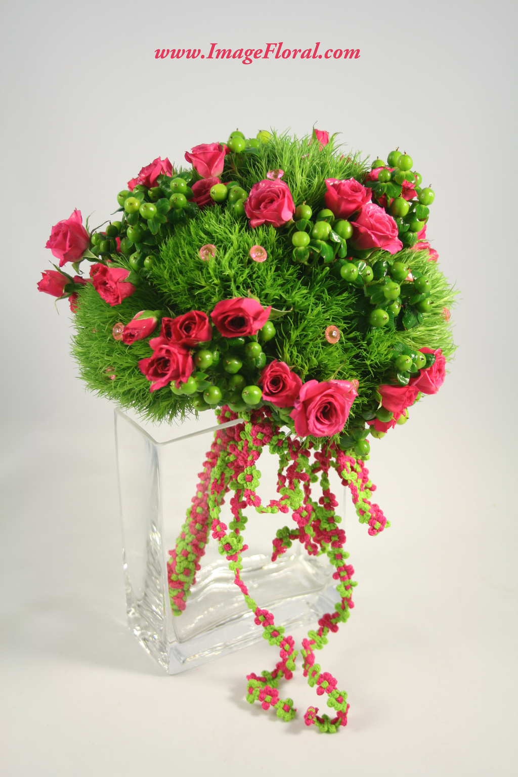 green berries hot pink roses bouquet