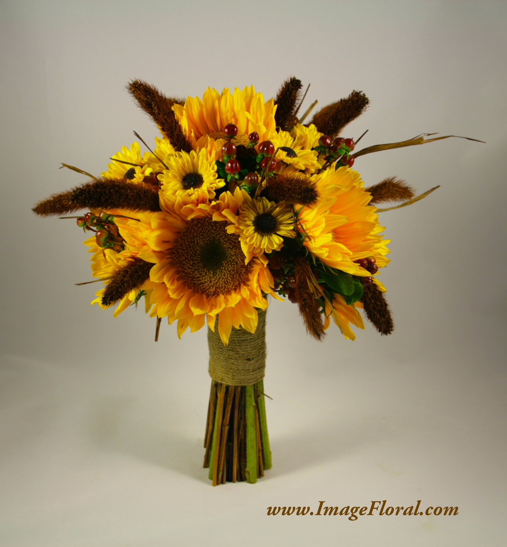 yellow sunflowers brown berries bouquet