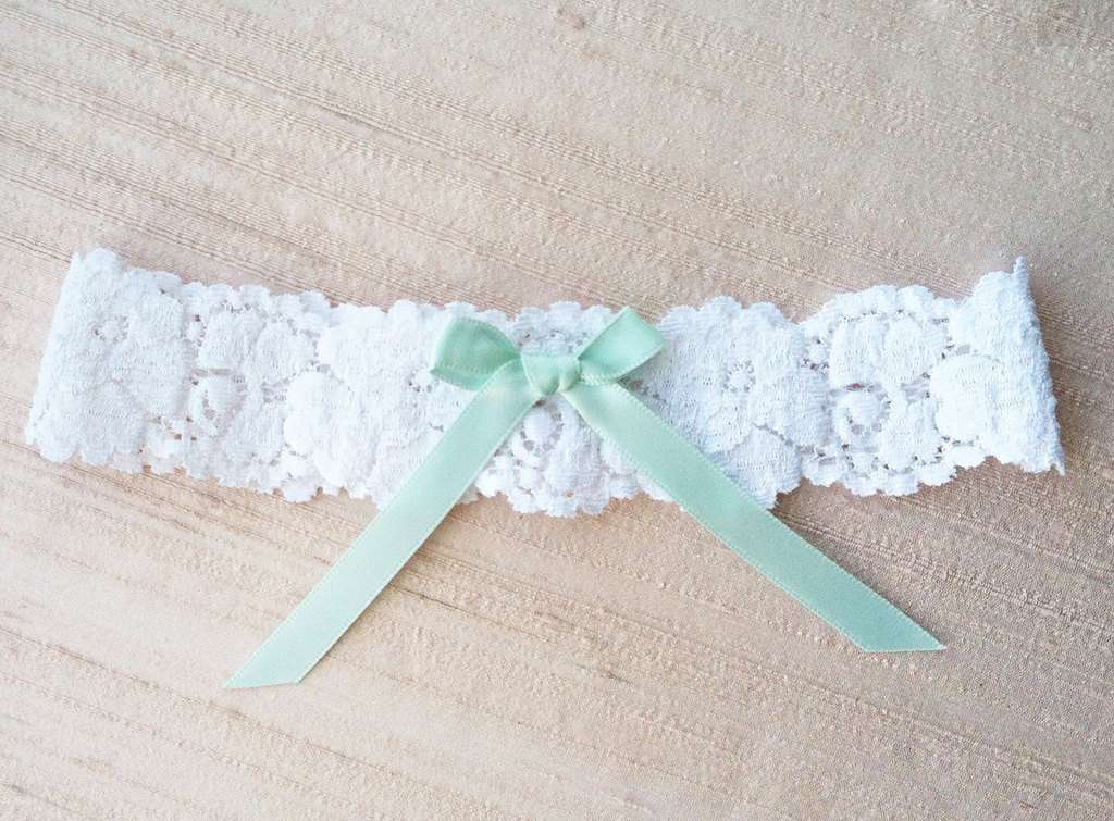 Delicate-white-lace-wedding-garter-with-mint-green-bow.full