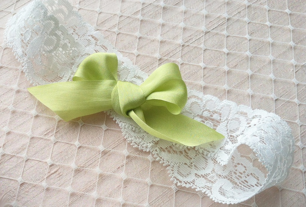 White-lace-wedding-garter-with-silk-bow-in-apple-green.full