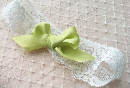 White lace wedding garter with silk bow in apple green