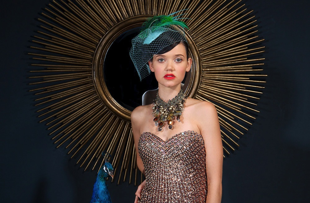 Green-and-teal-wedding-hat-with-blusher.full