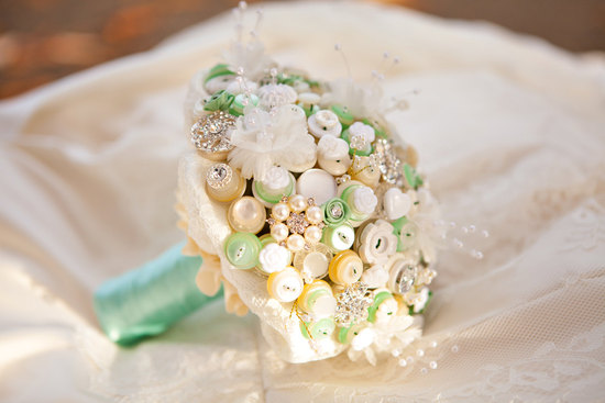 Elegant ivory pearl green wedding bouquet of buttons