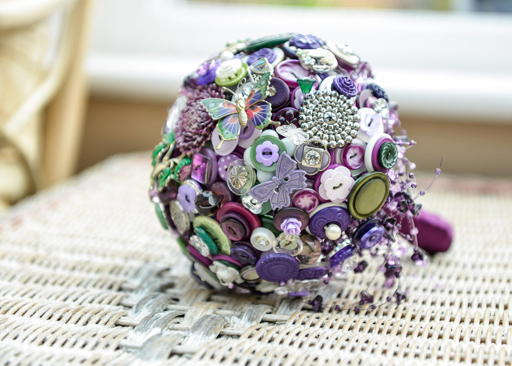 Whimsical wedding bouquet of brooches and buttons purple green silver