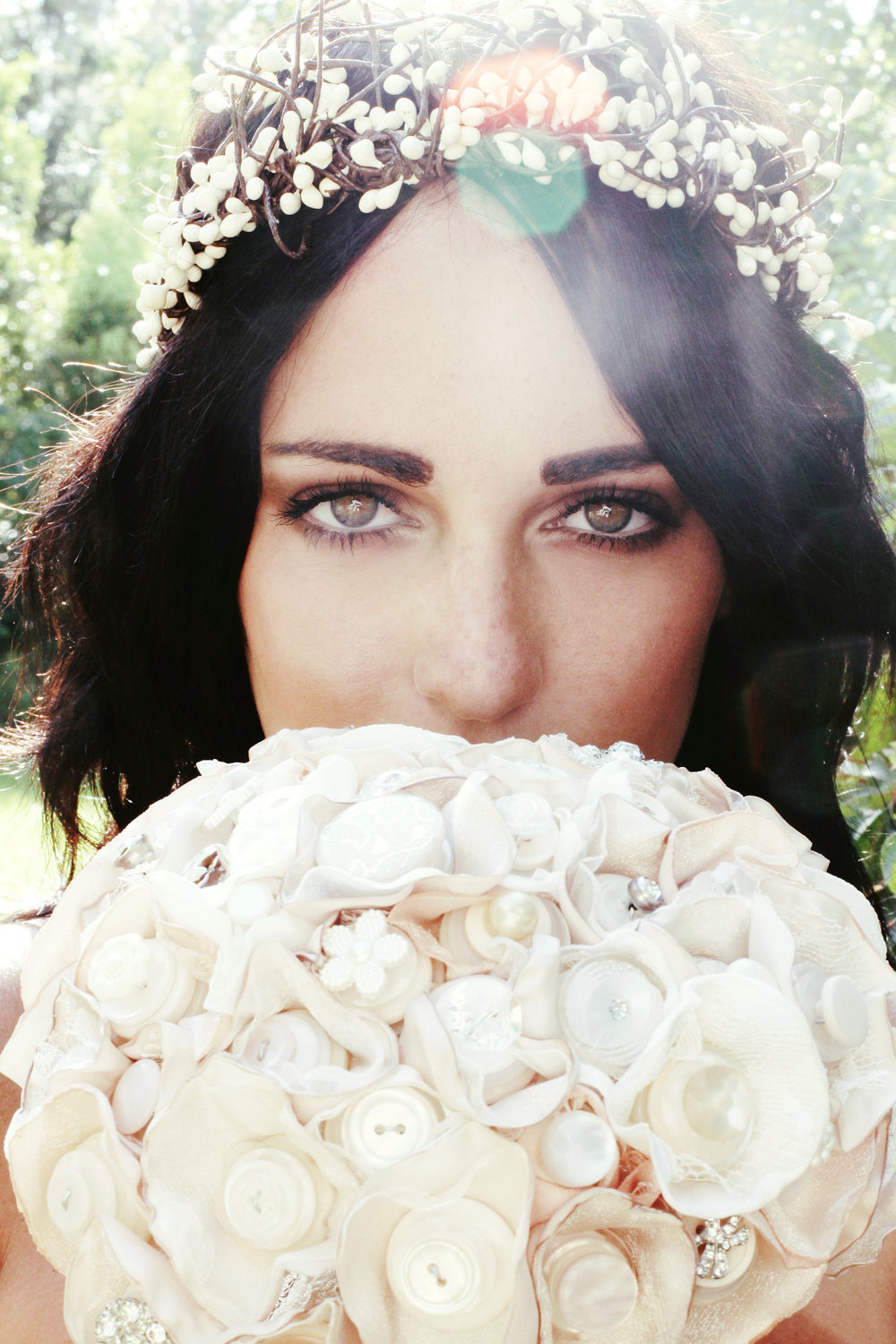 Bohemian-bride-wears-floral-hair-wreath-holds-button-bridal-bouquet.full