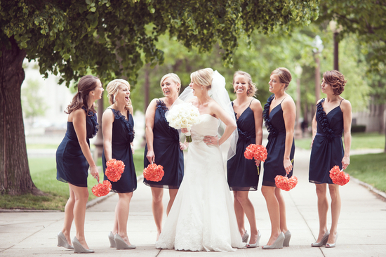 Classic bride with bridesmaids in navy coral bouquets