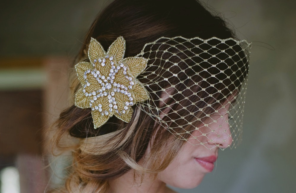 Gold-beaded-wedding-hair-flowers-with-blusher.full
