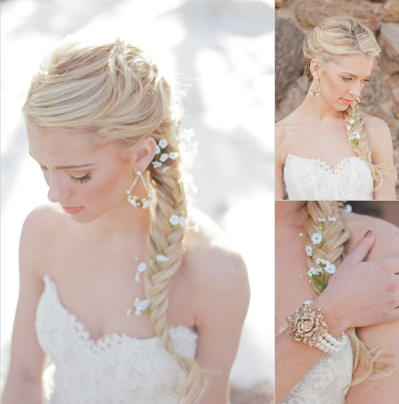 Low braided wedding ponytail with babys breath