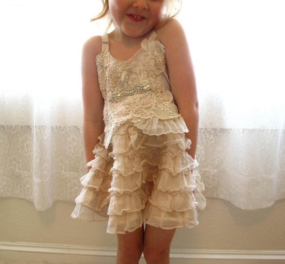 Lace-embellished-flower-girl-dress-adorable-wedding-photo.full
