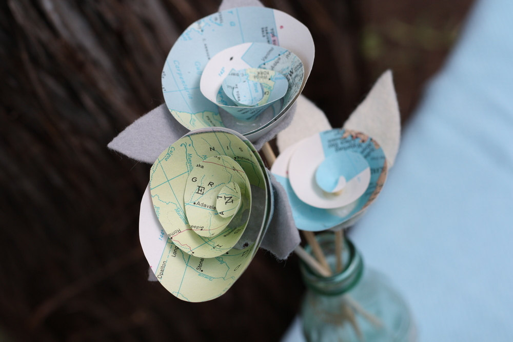Vintage map paper flower rosettes for wedding centerpieces