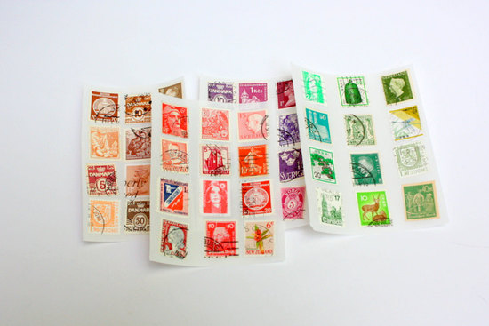 Colorful vintage stamps for travel themed wedding