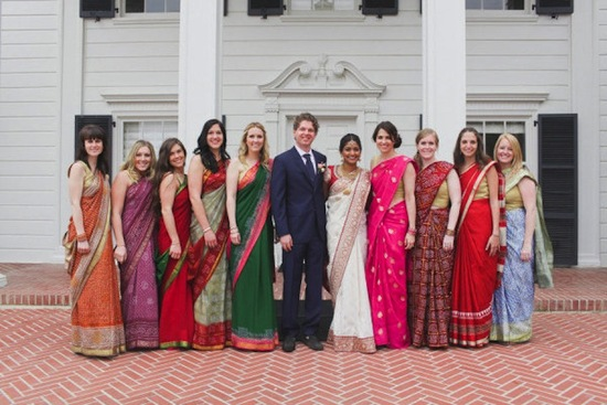 Multi cultural wedding bridesmaids in colorful saris
