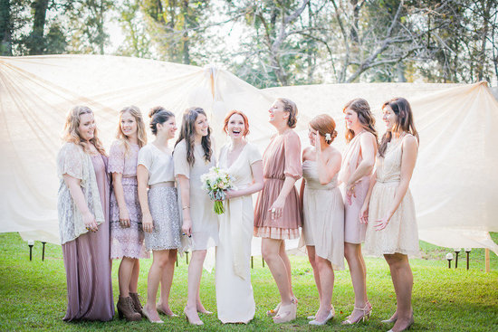 Casual bohemian wedding with mix and match bridesmaids in pastels