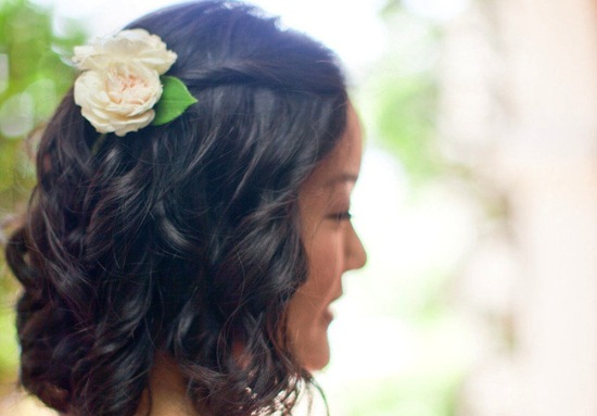 Classic curls wedding hairstyle with ivory flower
