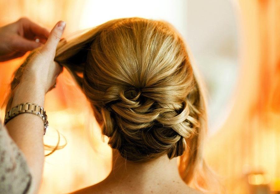 Sleek wedding hairstyle low updo | OneWed.com