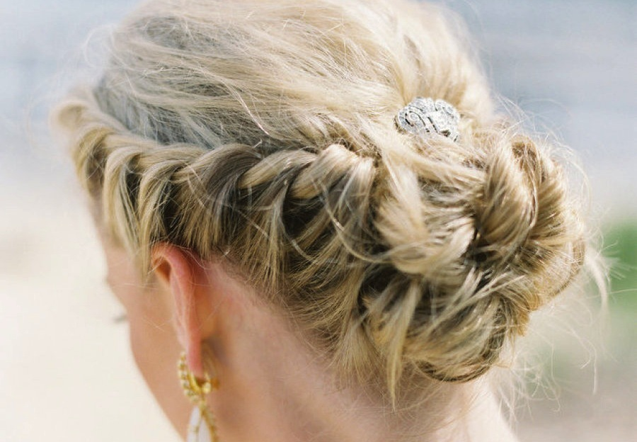 Regal-wedding-updo-braided-with-rhinestone-clip.full