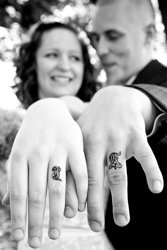 Black and white wedding photo ring tattoos
