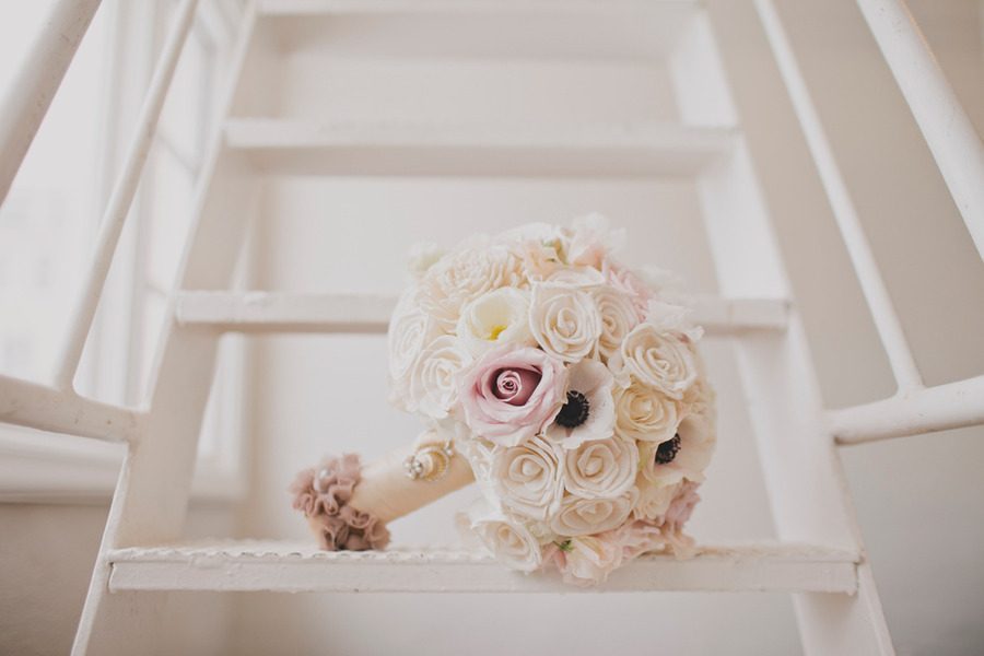 Classic wedding bouquet of ivory roses anemones dusty rose