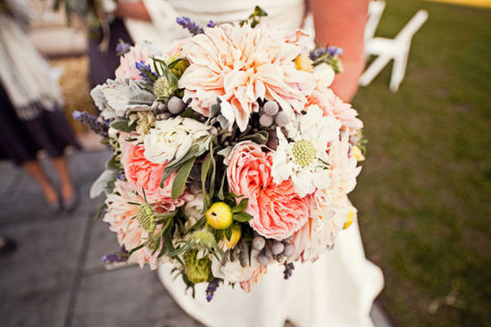 Unique wedding bouquet with dahlias roses berries