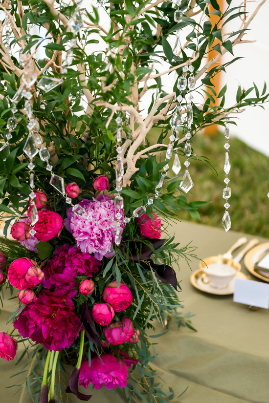 Bright pink wedding centerpieces with branches and crystals