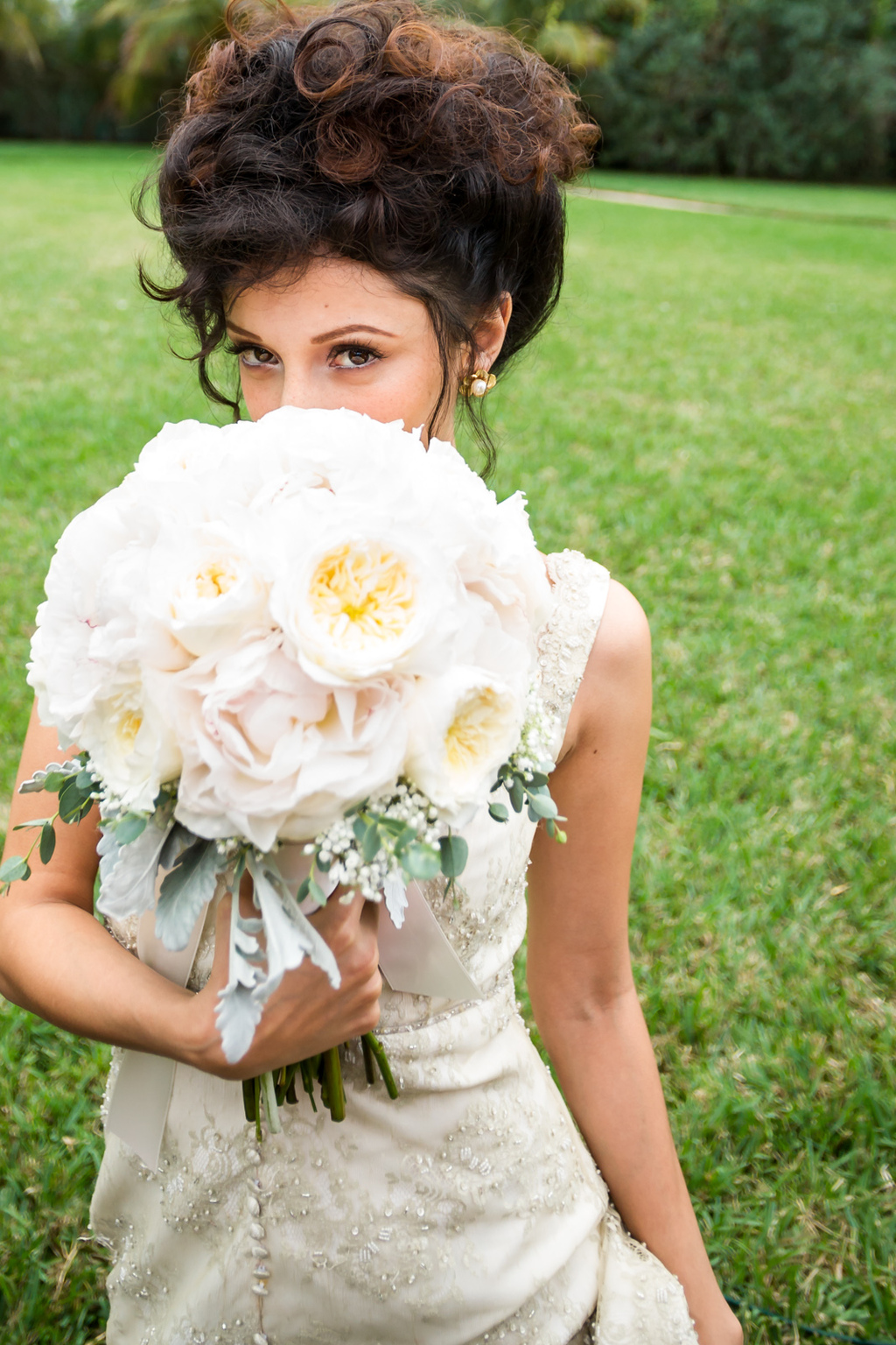 Vintage-bride-hides-behind-fluffy-peony-bouquet.full