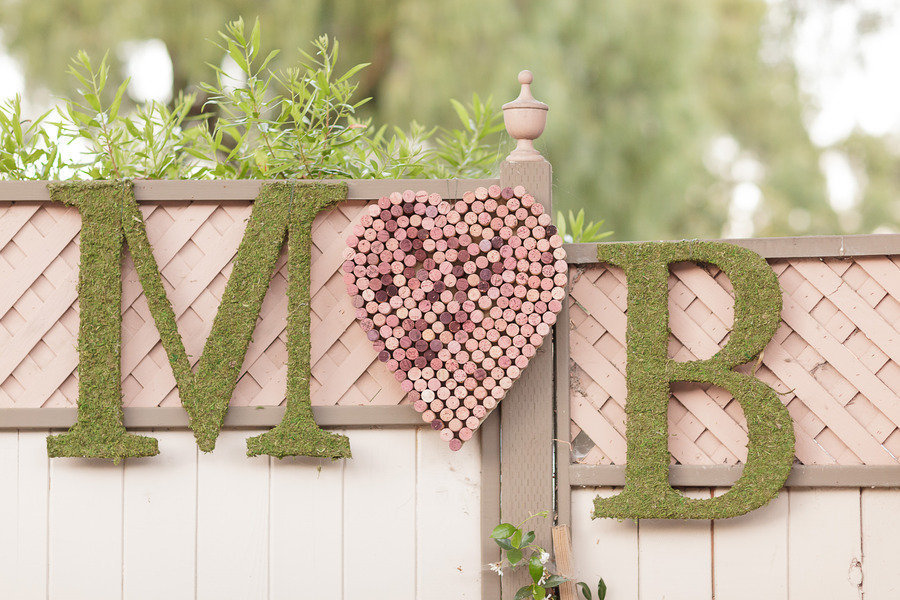 Awesome-wedding-sign-with-couples-initials-using-moss-and-wine-corks.full