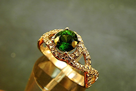 Gold and emerald wedding band or engagement ring