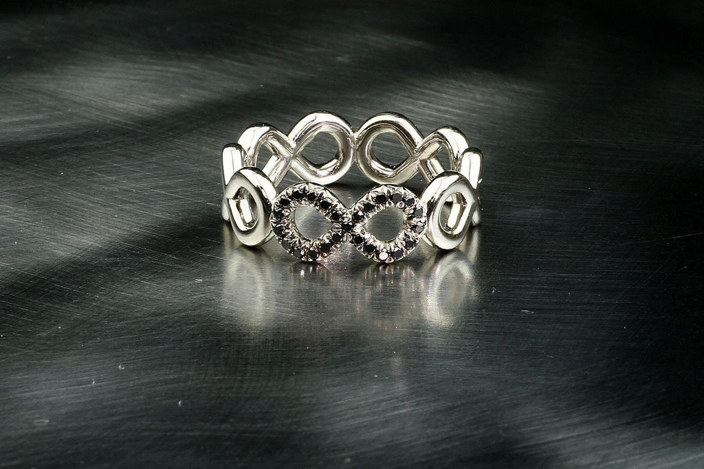 White gold infinity wedding ring with black diamonds