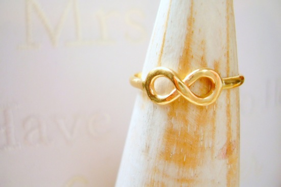 Handmade gold wedding band with infinity heart