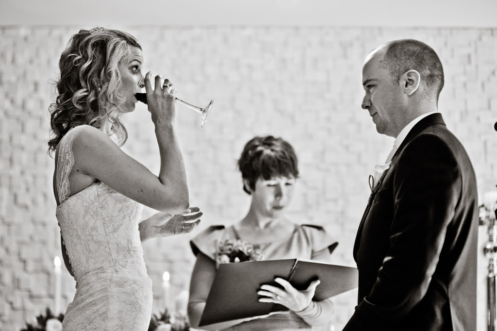 Bride-takes-a-sip-of-wine-at-wedding-ceremony.full
