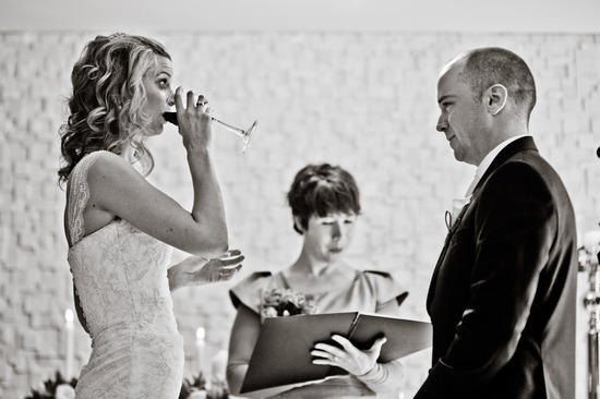 Bride takes a sip of wine at wedding ceremony