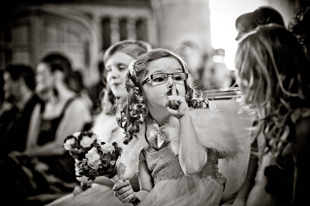 Priceless-wedding-photo-flower-girl-lays-the-smack-down.full
