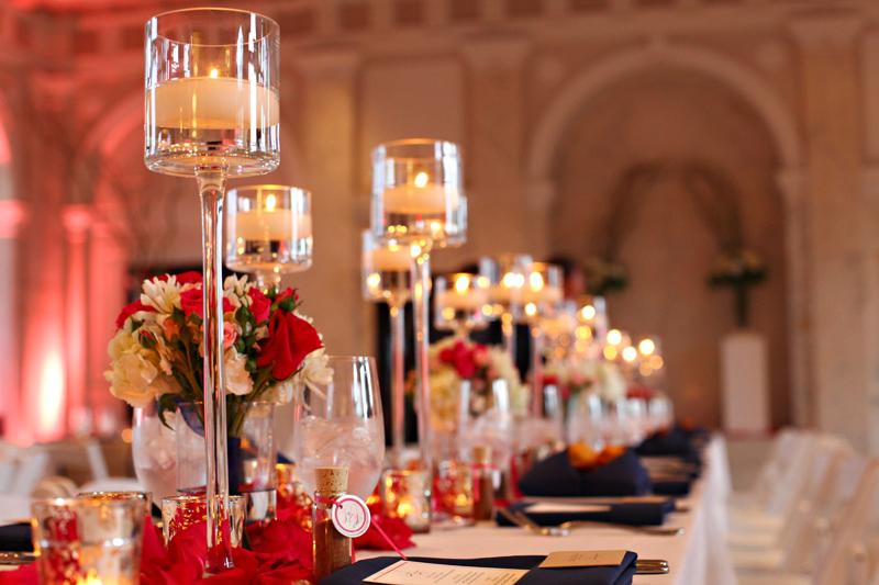Elegant reception venue glass candle wedding centerpiece