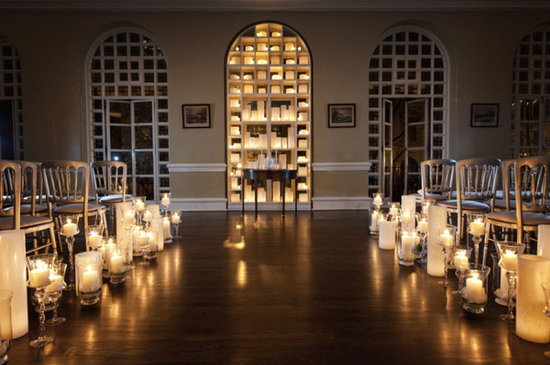 Candles lining wedding ceremony aisle