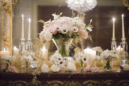 Romantic wedding reception welcome table with candles anemones and roses