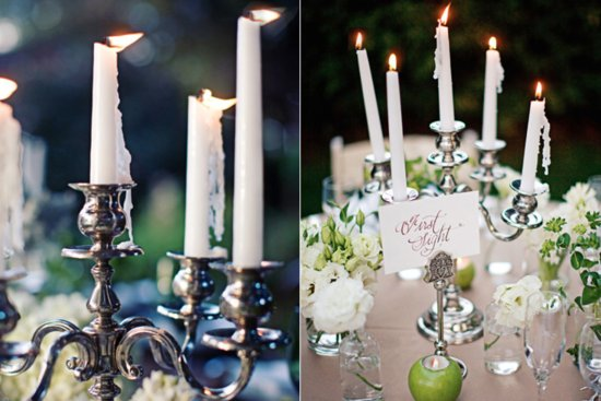 Silver candelabras with green apples and votives wedding reception table