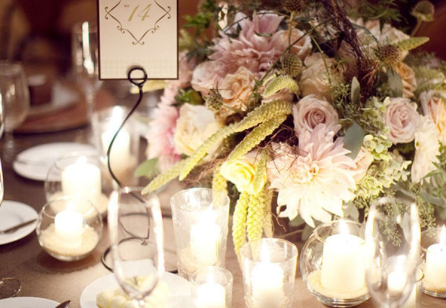 Romantic-wedding-centerpiece-surrounded-by-candles.full