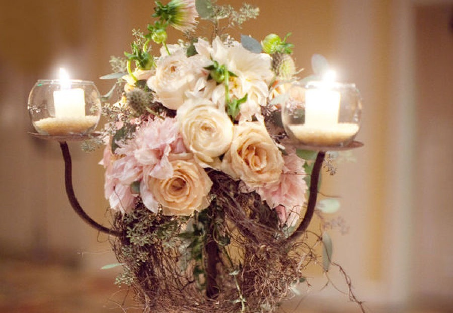 Romantic wedding centerpiece surrounded by candles