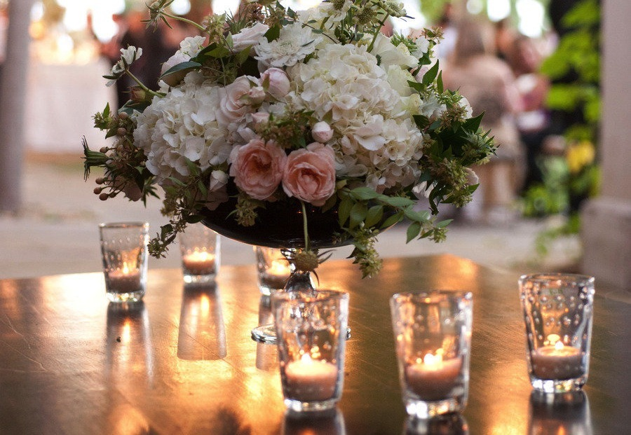 pink rose and white hydrangea wedding centerpiece with candles
