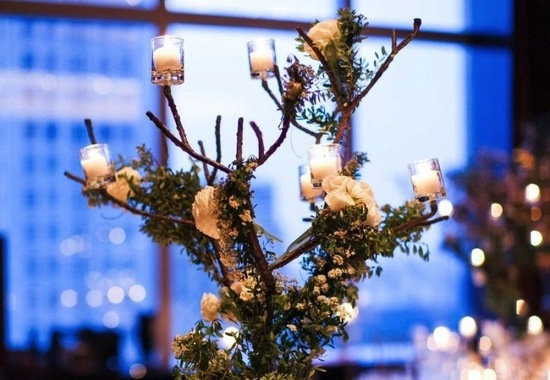 High branchy wedding centerpiece with votives