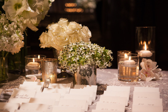 Elegant classic wedding reception escort card table with candles
