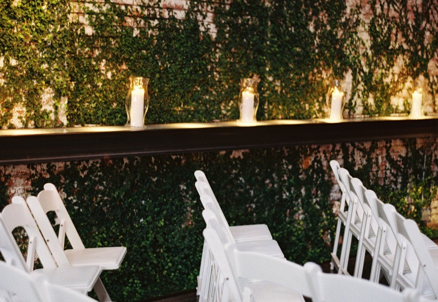 Outdoor Wedding Ceremony With Candles As Decor