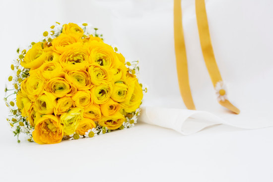 Yellow and white daisy and ranunculus bridal bouquet